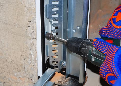 repairing garage door track